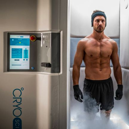 Man Standing In A Full Body Cryotherapy Machine